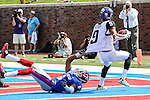 TCU Horned Frogs wide receiver Josh Doctson (9) and Southern Methodist Mustangs defensive back Jesse Montgomery (6) in action during the game between the TCU Horned Frogs and the SMU Mustangs at the Gerald J. Ford Stadium in Fort Worth, Texas. TCU defeats SMU 56 to 0.