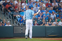 Omaha Storm Chasers Bobby Witt Jr. (7) points toward Ryan McBroom (not pictured) after scoring a run during a game against the Iowa Cubs on August 14, 2021 at Werner Park in Omaha, Nebraska. (Zachary Lucy/Four Seam Images)