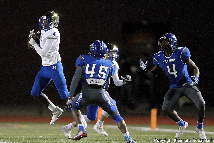 Boswell senior defensive back Jamayo Simms makes a second quarter interception during their 30-12 win over Dunbar in 5A high school football area playoff at Ranger Stadium in Fort Worth on Friday, November 18, 2016. The Pioneers had three interception and recovered 2 fumbles.