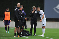 Monday 20th August 2018<br /> Pictured: Swansea City's Brandon Cooper receives treatment for cut eye <br /> Re: Swansea City U23 v Derby County U23 Premier League 2 match at the Landore Training facility, Swansea, Wales, UK