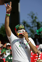 JUNE 11, 2006: Nuremberg, Germany: Iran fans cheered their team on before the game against Mexico at the World Cup Finals in Franken-Stadion in Nuremberg, Germany.  Mexico defeated Iran, 3-1.
