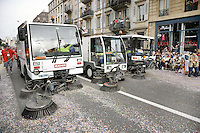Switzerland. Canton of Neuchâtel. Neuchâtel. Grape Harvest Festival. Garbage collectors. Streets cleaning. Three street brooming machines clean the confettis and various refuses on the concrete road  at the end of the parade.© 2006 Didier Ruef