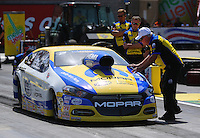 Mar 28, 2014; Las Vegas, NV, USA; Father of NHRA pro stock driver Allen Johnson is led into the staging beams by father Roy Johnson during qualifying for the Summitracing.com Nationals at The Strip at Las Vegas Motor Speedway. Mandatory Credit: Mark J. Rebilas-