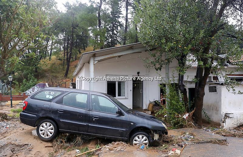 A car resting on a pile of mud and debris in Agia Triada