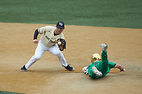 Michael Turconi (6) of the Wake Forest Demon Deacons fields a throw as Spencer Myers (2) of the Notre Dame Fighting Irish steals second base at David F. Couch Ballpark on March 10, 2019 in  Winston-Salem, North Carolina. The Demon Deacons defeated the Fighting Irish 7-4 in game one of a double-header.  (Brian Westerholt/Four Seam Images)