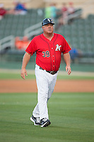 Kannapolis Intimidators manager Tommy Thompson (39) walks off the field after having a discussion with base umpire Christopher Lloyd (not pictured) during the game against the Delmarva Shorebirds at CMC-Northeast Stadium on June 6, 2015 in Kannapolis, North Carolina.  The Shorebirds defeated the Intimidators 7-2.  (Brian Westerholt/Four Seam Images)