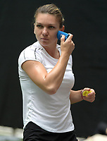 MIAMI GARDENS, FLORIDA - MARCH 20: Simona Halep applies sunblock during the Miami Open day 3. Simona Halep is a Romanian professional tennis player. The Women's Tennis Association ranked her world No. 1 in singles on two separate occasions between 2017 and 2019. She reached the No. 1 ranking for the first time on October 9, 2017. On her second occasion, she held the ranking for 48 consecutive weeks. Presented by Itau at Hard Rock Stadium March 20, 2019 in Miami Gardens, Florida<br /> <br /> People: Simona Halep