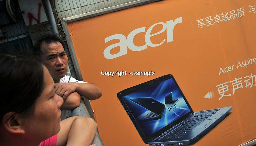 An Acer advertisement in Guangzhou, China. The financial crisis won't have too much impact on Chinese consuming market. According to a survey by Nielsen of 50 countries and regions, only 35 percent of Chinese people believed the domestic economy was in a contraction. The figure was the lowest among the 50 world markets..