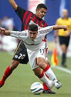 17 April 2004: DC United Alecko Eskandarian battles for the ball against MetroStars Amado Guevara at Giants' Stadium in East Rutherford, New Jersey.   MetroStars defeated DC United, 3-2.