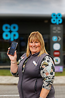 Store manager Louise Hughes with the Co op app.