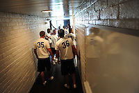 Jun. 13, 2009; Las Vegas, NV, USA; Quarterbacks wait in a hallway to be weighed and measured prior to the United Football League workout at Sam Boyd Stadium. Mandatory Credit: Mark J. Rebilas-