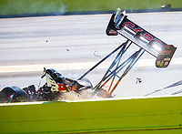 Oct 15, 2017; Ennis, TX, USA; NHRA top fuel driver Steve Torrence blows a tire and crashes his dragster as he wins in the second round of the Fall Nationals at the Texas Motorplex. Torrence walked away from the crash. Mandatory Credit: Mark J. Rebilas-USA TODAY Sports