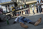 © Remi OCHLIK/IP3 - Cap Haitien on 2010 november 16 - Locals in Haiti's second city of Cap Haitien have challenged UN peacekeepers for a second consecutive day, throwing stones at patrolling teams and calling for their removal from the country..The incidents on Tuesday morning came a day after the deaths of at least two people during clashes between residents and UN troops during a protest over an outbreak of cholera in the country..Some Haitians blame Nepalese peacekeepers for the epidemic..Haitian dead from cholera lays in the streets of Cap Haitien.