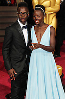 HOLLYWOOD, CA, USA - MARCH 02: Peter Nyong'o Jr, Lupita Nyong'o at the 86th Annual Academy Awards held at Dolby Theatre on March 2, 2014 in Hollywood, Los Angeles, California, United States. (Photo by Xavier Collin/Celebrity Monitor)