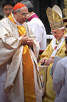 Pope Benedict XVI (L) gives his cardinal ring to Italian Paolo Romeo (R) during the Eucharistic celebration with the new cardinals on November 21, 2010 at St Peter's basilica at The Vatican. 24 Roman Catholic prelates joined the day before the Vatican's College of Cardinals, the elite body that advises the pontiff and elects his successor upon his death.