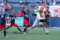 FOXBOROUGH, MA - JULY 4: Maxwell Hemmings #5 of Greenville Triumph SC under pressure near the New England Revolution II II goal during a game between Greenville Triumph SC and New England Revolution II at Gillette Stadium on July 4, 2021 in Foxborough, Massachusetts.