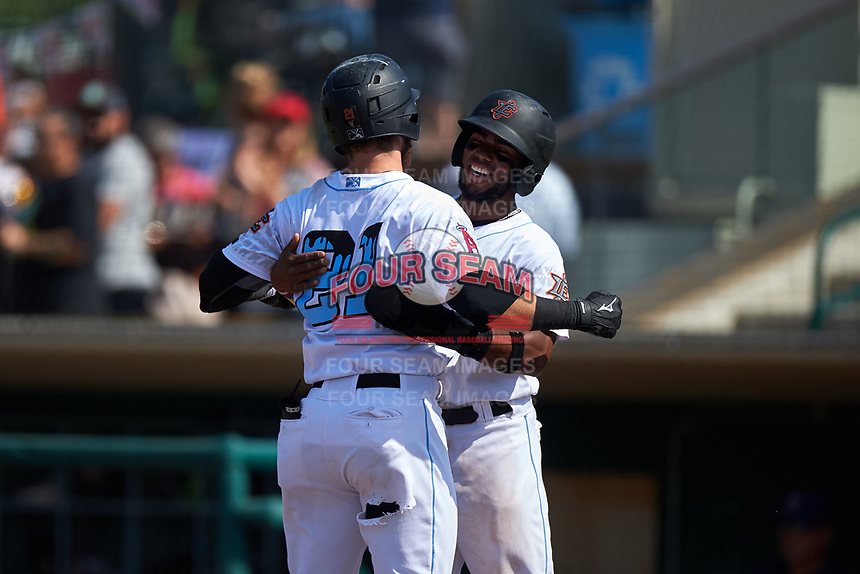 Inland Empire 66ers shortstop Luis Rengifo (3) congratulates Jared Walsh (21) after his two-run home run during a California League game against the Lancaster JetHawks at San Manuel Stadium on May 20, 2018 in San Bernardino, California. Inland Empire defeated Lancaster 12-2. (Zachary Lucy/Four Seam Images)