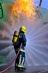 Pic Kenny Smith.........11/05/05.Airport Firemen extinguish a fire on a new purpose built simulator at Edinburgh Airport as part of an exercise today.