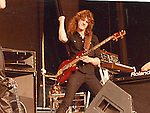 Neil Murray performing live with Gary Moore at Reading Rock Festival in England 1982