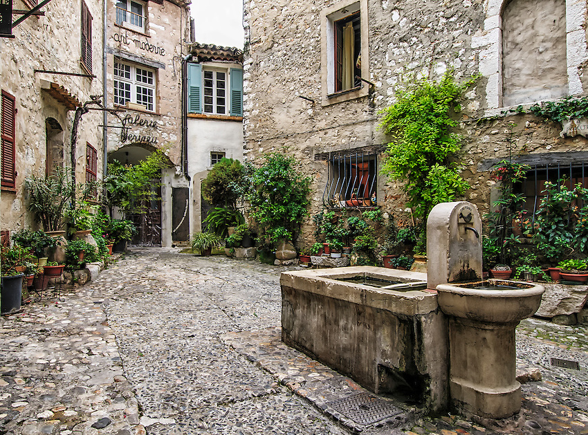 """La Placette"", a small courtyard with a fountain in Saint-Paul-de-Vence, France"