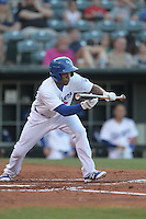 Oklahoma City Dodgers center fielder Antoan Richardson (3) bunts during a game against the Omaha Storm Chasers at Chickasaw Bricktown Ballpark on June 16, 2016 in Oklahoma City, Oklahoma. Oklahoma City defeated Omaha 5-4  (William Purnell/Four Seam Images)