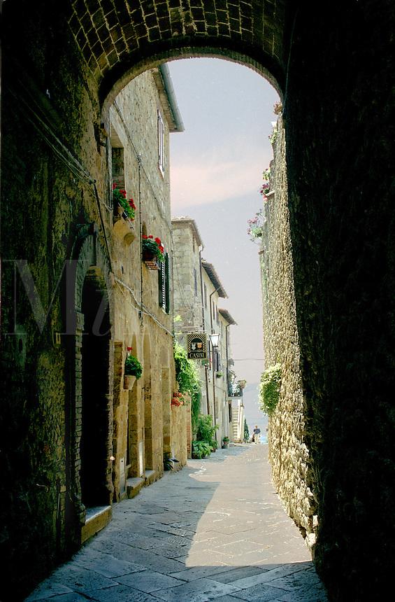 Narrow street seen through arched buttress
