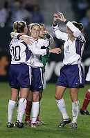 Aly Wagner (10) is congratulated by Kristine Lilly, center and Julie Foudy, right, after scoring during a 5-0 victory over Mexico at the Home Depot Center in Carson, Calif., Tuesday, Dec., 7, 2004.