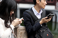 Young Chinese people using their cellphones.<br /> <br /> To license this image, please contact the National Geographic Creative Collection:<br /> <br /> Image ID: 2169187  <br /> <br /> Email: natgeocreative@ngs.org<br /> <br /> Telephone: 202 857 7537 / Toll Free 800 434 2244<br /> <br /> National Geographic Creative<br /> 1145 17th St NW, Washington DC 20036