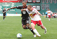 Jordan Graye #16 of D.C. United challenges for the ball with Joel Lindpere #20 of the New York Red Bulls during an MLS match on May 1 2010, at RFK Stadium in Washington D.C.