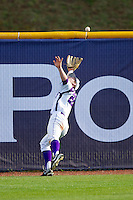 High Point Panthers left fielder Sean Wilson #22 can't quite get to this fly ball against the Manhattan Jaspers at Willard Stadium on March 9, 2012 in High Point, North Carolina.  The Panthers defeated the Jaspers 11-6.  (Brian Westerholt/Four Seam Images)