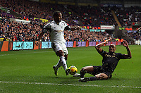 Wednesday, 01 January 2014<br /> Pictured L-R: Wayne Routledge of Swansea against Vincent Kompany of Manchester City.<br /> Re: Barclay's Premier League, Swansea City FC v Manchester City at the Liberty Stadium, south Wales.