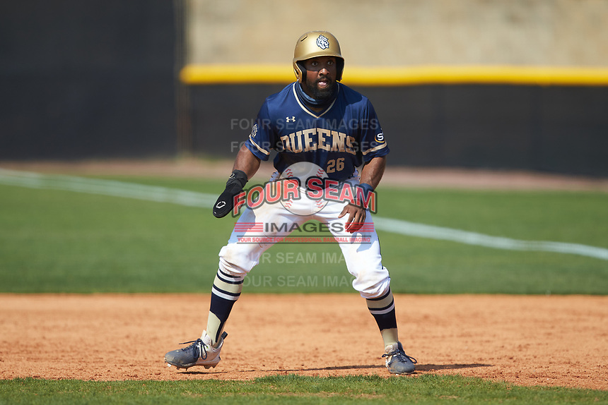 Noah Jones (26) of the Queens Royals takes his lead off of first base during game two of a double-header against the Catawba Indians at Tuckaseegee Dream Fields on March 26, 2021 in Kannapolis, North Carolina. (Brian Westerholt/Four Seam Images)