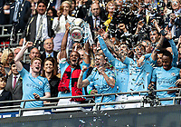 Captain Vincent Kompany of Manchester City lifts the FA Cup during the FA CUP FINAL match between Manchester City and Watford at Wembley Stadium, London, England on 18 May 2019. Photo by Andy Rowland.