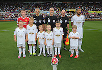 Pictured: Chldren mascots with Manchester United captain Wayne Rooney, referee Martin Atkinson and Swansea captain Ashley Williams Sunday 30 August 2015<br /> Re: Premier League, Swansea v Manchester United at the Liberty Stadium, Swansea, UK