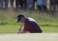 17th July 2021; Royal St Georges Golf Club, Sandwich, Kent, England; The Open Championship Golf, Day Three; Jordan Speith (USA) splashes out of the greenside bunker at the par three 11th hole