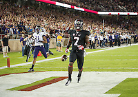 STANFORD, CA - October 5, 2013:  Stanford Cardinal wide receiver Ty Montgomery (7) runs back the opening kickoff for a touchdown during the Stanford Cardinal vs the Washington Huskies at Stanford Stadium in Stanford, CA. Final score Stanford Cardinal 31, Washington Huskies  28.