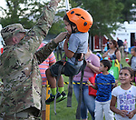 Samuel Salano, 3, checks out the climbing wall during the 14th annual National Night Out in Carson City, Nev., on Tuesday, Aug. 2, 2016. <br />