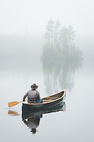 """""""Spring Serenity""""<br /> <br /> The canoeist paddles through the serenity and mystery of the saturated spring landscape. A symphony of birdsong penetrates the thick blanket of fog. These life-enriching experiences with nature nourish and heal the mind, body, and soul."""