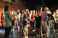 "Assistant Director, Jules Black, talking to the cast.  The Yvonne Arnaud Youth Theatre rehearsing ""The Lion, the Witch and the Wardrobe"", Guildford, Surrey."