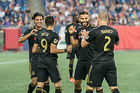 FOXBOROUGH, MA - AUGUST 3: Carlos Vela #10 of Los Angeles FC, Diego Rossi #9 of Los Angeles FC, ;Steven Beitashour #3 of Los Angeles FC and Jordan Harvey #2 of Los Angeles FC celebrate the first goal of the game during a game between Los Angeles FC and New England Revolution at Gillette Stadium on August 3, 2019 in Foxborough, Massachusetts.