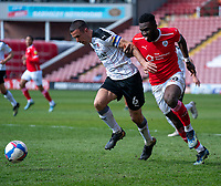24th April 2021, Oakwell Stadium, Barnsley, Yorkshire, England; English Football League Championship Football, Barnsley FC versus Rotherham United; Daryl Dike of Barnsley and Richard Wood of Rotherham challenge for possession