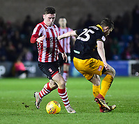 Lincoln City's Shay McCartan vies for possession with  Newport County's Mark O'Brien<br /> <br /> Photographer Andrew Vaughan/CameraSport<br /> <br /> The EFL Sky Bet League Two - Lincoln City v Newport County - Saturday 22nd December 201 - Sincil Bank - Lincoln<br /> <br /> World Copyright © 2018 CameraSport. All rights reserved. 43 Linden Ave. Countesthorpe. Leicester. England. LE8 5PG - Tel: +44 (0) 116 277 4147 - admin@camerasport.com - www.camerasport.com