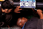 Teenagers in workplace  auto repair.two male students working on car