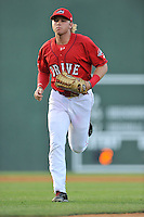 Left fielder Trenton Kemp (17) of the Greenville Drive runs in from the outfield in a game against the Greensboro Grasshoppers on Thursday, July 14, 2016, at Fluor Field at the West End in Greenville, South Carolina. Greenville won, 3-1. (Tom Priddy/Four Seam Images)