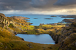 South Harris, Isle of Lewis and Harris, Scotland:<br /> Clearing evening storm clouds over an isolated coastal village