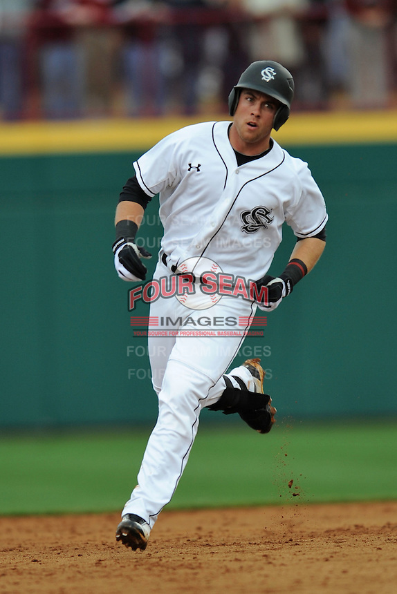 Third Baseman LB Dantzler #20 of the South Carolina Gamecocks rounds the bases hittiing a home run during a game against the South Carolina Gamecocks at Carolina Stadium on March 3, 2012 in Columbia, South Carolina. The Gamecocks defeated the Tigers 9-6. Tony Farlow/Four Seam Images.