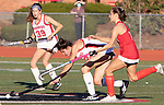 CHESHIRE CT. - 09 November 2020-110920SV01-#12 Lauren Houle of Cheshire reaches for the ball as #7 Andrea Amarante of Branford defends during the semifinals of SCC field hockey tournament in Cheshire Monday. #39 Danielle Floyd of Cheshire follows the play.<br /> Steven Valenti Republican-American