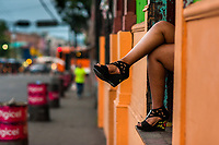 A Salvadoran sex worker, waiting for clients, sits in the door of a street sex bar in San Salvador, El Salvador, 7 April 2018. Although prostitution is not legal in El Salvador, dozens of street sex workers, wearing provocative miniskirts, hang out in the dirty streets close to the capital's historic center. Sex workers of all ages are seen on the streets but a significant part of them are single mothers abandoned by their male partners. Due to the absence of state social programs, they often seek solutions to their economic problems in sex work. The environment of street sex business is strongly competitive and dangerous, closely tied to the criminal networks (street gangs) that demand extortion payments. Therefore, sex workers employ any tool at their disposal to struggle hard, either with their fellow workers, with violent clients or with gang members who operate in the harsh world of street prostitution.