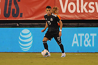 EAST RUTHERFORD, NJ - SEPTEMBER 7: Hector Moreno #15 of Mexico kicks the ball during a game between Mexico and USMNT at MetLife Stadium on September 6, 2019 in East Rutherford, New Jersey.