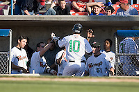C.J. Retherford (10) of the Winston-Salem Warthogs is greeted in the dugout by his teammates following his solo home run in the 5th inning at Ernie Shore Field in Winston-Salem, NC, Saturday, May 17, 2008.